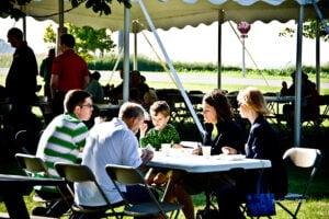 people eating breakfast on the farm