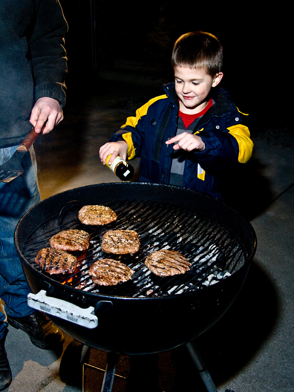 dad and son grilling burgers