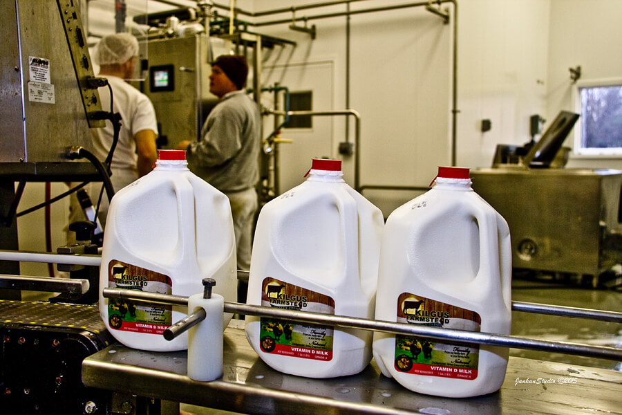 milk jugs at bottling plant