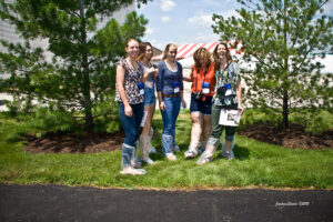 tour group poses on the farm
