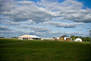 our barn and pasture with big puffy clouds in the sky