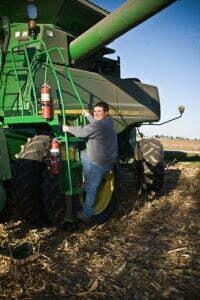 Matt Kilgus climbing into tractor